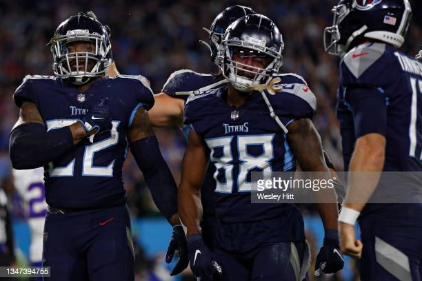 Running back Derrick Henry of the Tennessee Titans celebrates after scoring a touchdown against the Buffalo Bills during the fourth quarter at Nissan...