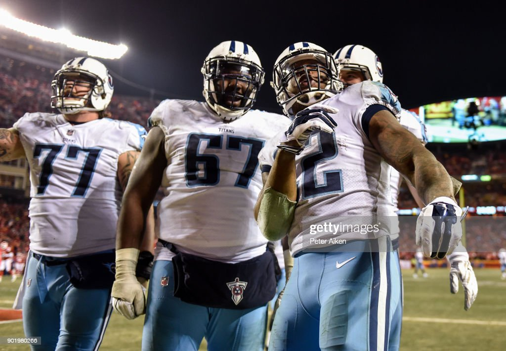 Running back Derrick Henry #22 of the Tennessee Titans celebrates with teammates offensive tackle Taylor Lewan #77 and offensive guard Quinton Spain #67 after scoring a touchdown during the fourth quarter of the AFC Wild Card Playoff Game against the Kansas City Chiefs at Arrowhead Stadium on January 6, 2018 in Kansas City, Missouri.