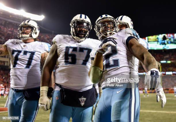 Running back Derrick Henry of the Tennessee Titans celebrates with teammates offensive tackle Taylor Lewan and offensive guard Quinton Spain after...