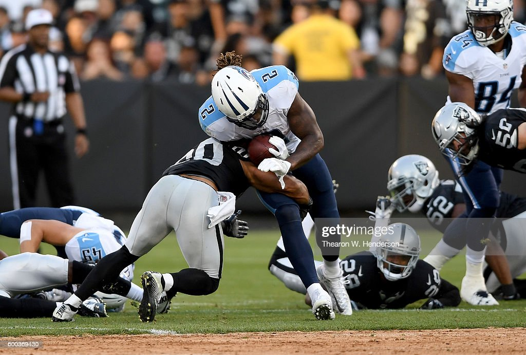 98f190f03f1 Running back Derrick Henry of the Tennessee Titans gets tackled by ...