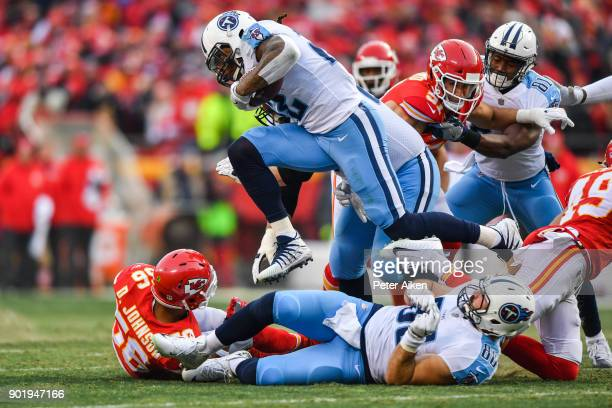 Running back Derrick Henry of the Tennessee Titans leaps over a pile of players during the second quarter of the AFC Wild Card playoff game against...