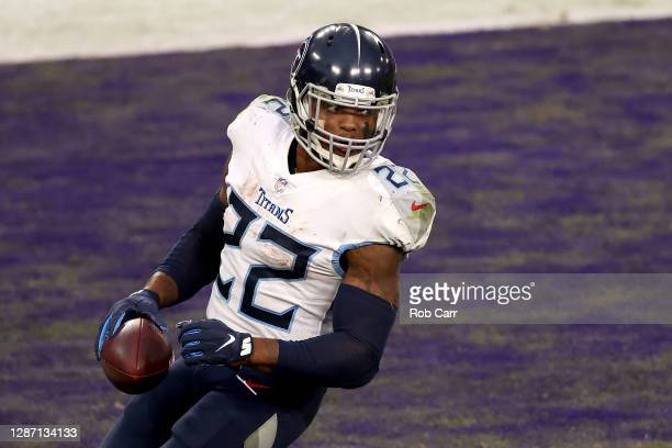 Running back Derrick Henry of the Tennessee Titans looks back after scoring the game winning touchdown in overtime against the Baltimore Ravens at...