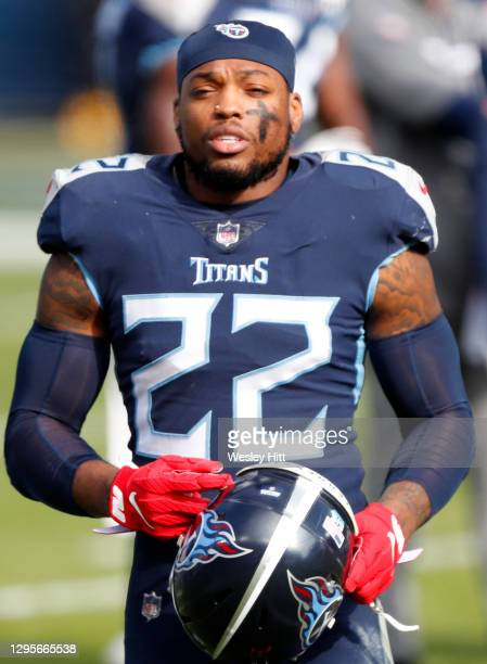 Running back Derrick Henry of the Tennessee Titans looks on during the first quarter of their AFC Wild Card Playoff game against the Baltimore Ravens...
