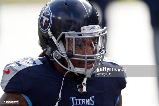Running back Derrick Henry of the Tennessee Titans looks on prior to their AFC Wild Card Playoff game against the Baltimore Ravens at Nissan Stadium...