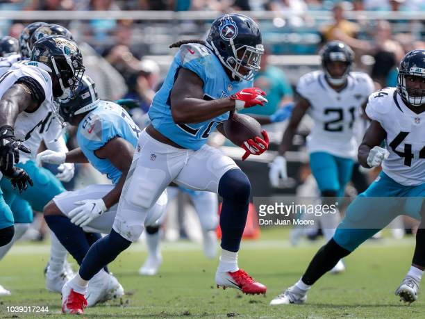 Running back Derrick Henry of the Tennessee Titans on a run play during the game against the Jacksonville Jaguars at TIAA Bank Field on September 23...