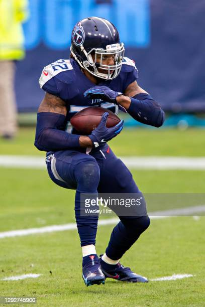 Running back Derrick Henry of the Tennessee Titans runs the ball during a game against the Detroit Lions at Nissan Stadium on December 20, 2020 in...