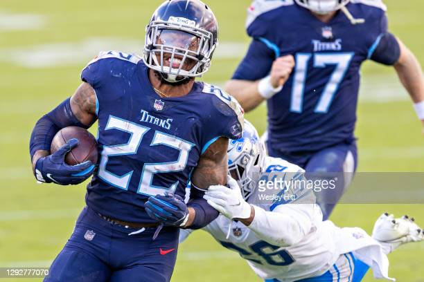 Running back Derrick Henry of the Tennessee Titans runs the ball and avoids the tackle of safety Duron Harmon of the Detroit Lions at Nissan Stadium...