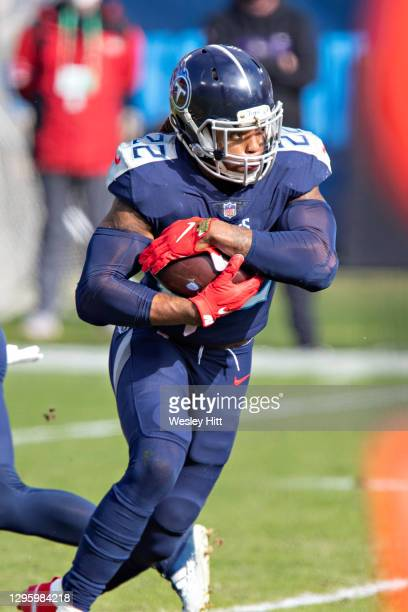 Running back Derrick Henry of the Tennessee Titans runs the ball during their AFC Wild Card Playoff game against the Baltimore Ravens at Nissan...