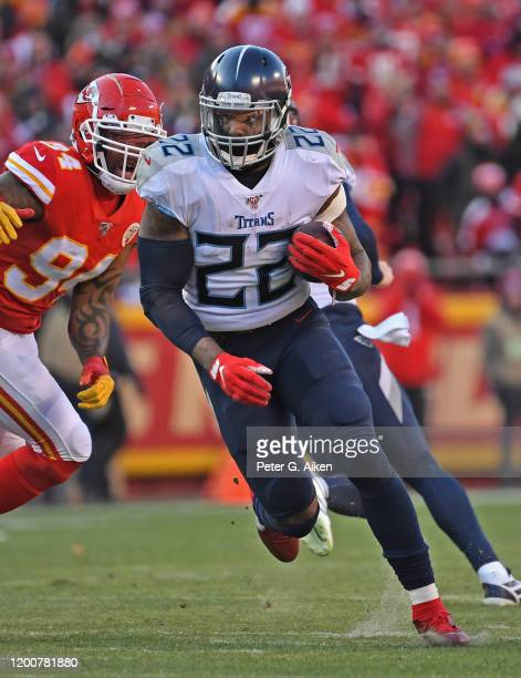 Running back Derrick Henry of the Tennessee Titans runs up field against the Kansas City Chiefs in the first half in the AFC Championship Game at...