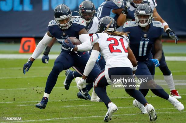 Running back Derrick Henry of the Tennessee Titans runs with the ball against Bradley Roby of the Houston Texans in the first quarter at Nissan...