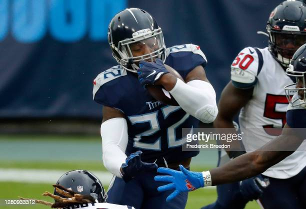 Running back Derrick Henry of the Tennessee Titans runs with the ball in the first quarter against the Houston Texans at Nissan Stadium on October...