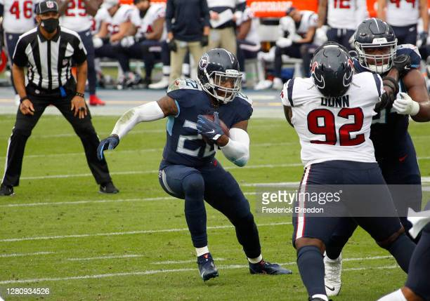 Running back Derrick Henry of the Tennessee Titans runs with the ball against the Houston Texans at Nissan Stadium on October 18, 2020 in Nashville,...