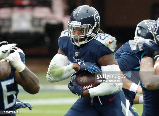 Running back Derrick Henry of the Tennessee Titans runs with the ball in the third quarter against the Houston Texans at Nissan Stadium on October...