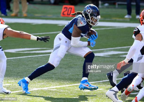 Running back Derrick Henry of the Tennessee Titans runs with the ball for a touchdown against the Cincinnati Bengals in the end zone in the second...