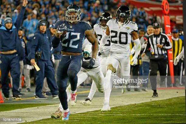 Running back Derrick Henry of the Tennessee Titans rushes against the Jacksonville Jaguars at Nissan Stadium on December 6 2018 in Nashville Tennessee