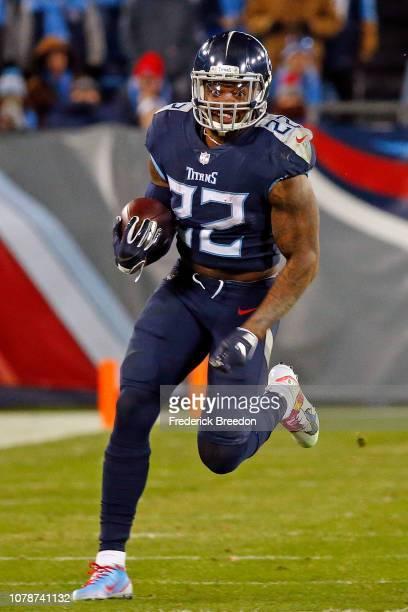 Running back Derrick Henry of the Tennessee Titans rushes against the Jacksonville Jaguars at Nissan Stadium on December 6, 2018 in Nashville,...