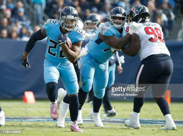 Running back Derrick Henry of the Tennessee Titans rushes against the Houston Texans during the first half at Nissan Stadium on December 15, 2019 in...