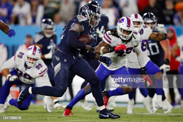 Running back Derrick Henry of the Tennessee Titans rushes against the Buffalo Bills during the third quarter at Nissan Stadium on October 18, 2021 in...