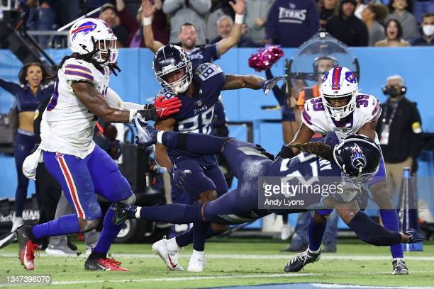 Running back Derrick Henry of the Tennessee Titans rushes for a touchdown against the Buffalo Bills during the fourth quarter at Nissan Stadium on...