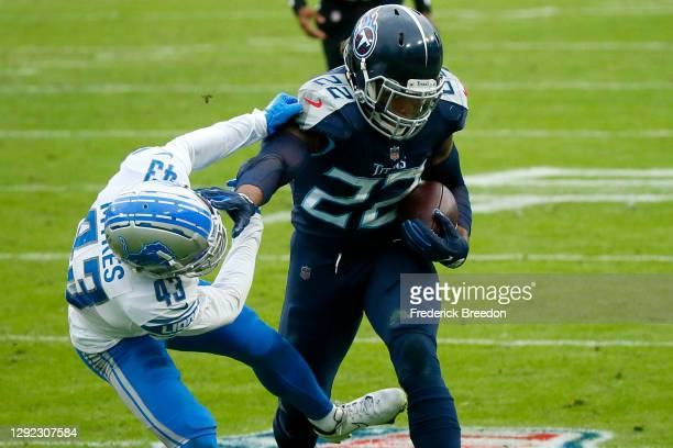 Running back Derrick Henry of the Tennessee Titans stiff arms cornerback Alexander Myers#43 of the Detroit Lions during the second quarter of the...