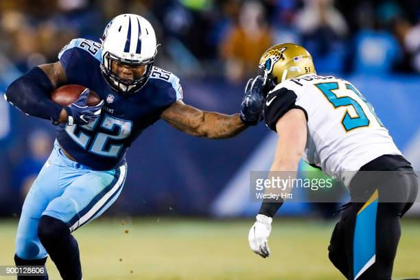 Running Back Derrick Henry of the Tennessee Titans stiff arms Linebacker Paul Posluszny of the Jacksonville Jaguars at Nissan Stadium on December 31...