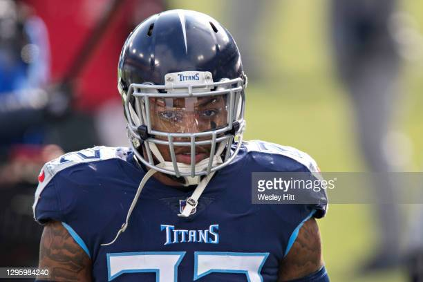 Running back Derrick Henry of the Tennessee Titans walks to the locker room before their AFC Wild Card Playoff game against the Baltimore Ravens at...