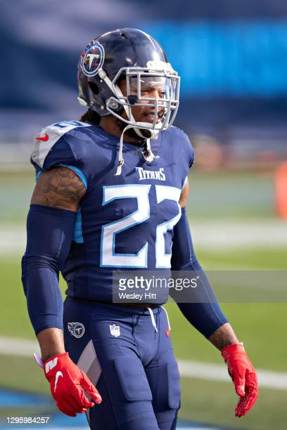 Running back Derrick Henry of the Tennessee Titans warms up before their AFC Wild Card Playoff game against the Baltimore Ravens at Nissan Stadium on...