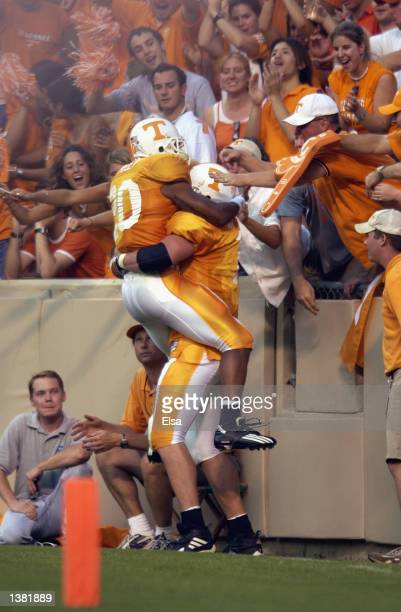 Running back Derrick Tinsley of the Tennessee Volunteers celebrates a touchdown with a lineman during the NCAA football game against the Middle...
