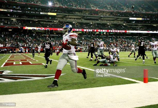 Running back Derrick Ward of the New York Giants scores a touchdown in the fourth quarter against the Atlanta Falcons at Georgia Dome on October 15,...
