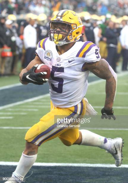 LSU running back Derrius Guice scores a touchdown late in the fourth quarter during the Citrus Bowl at Camping World Stadium Monday Jan 1 2018 in...