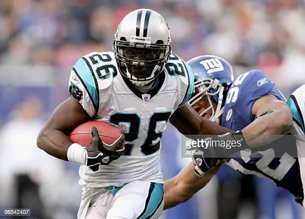 Running back DeShaun Foster of the Carolina Panthers carries the ball in the fourth quarter of the NFC Wild Card Playoff Game against the New York...