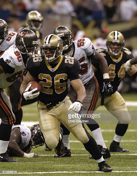 Running back Deuce McAllister of the New Orleans Saints carries the ball during the game against the Tampa Bay Buccaneers on Sunday October 10, 2004...