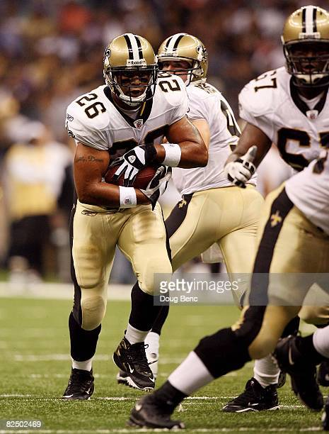 Running back Deuce McAllister of the New Orleans Saints looks for room to run while taking on the Houston Texans during a preseason game at Louisiana...