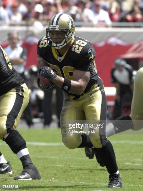 Running back Deuce McAllister of the New Orleans Saints runs for a gain against the Tampa Bay Buccaneers during a weektwo NFL game on September 16...