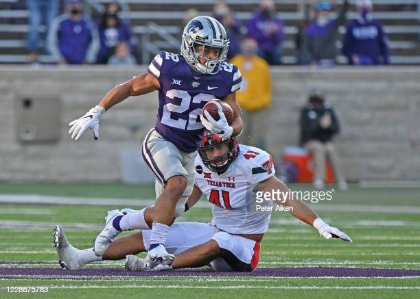 Running back Deuce Vaughn of the Kansas State Wildcats rushes past linebacker Jacob Morgenstern of the Texas Tech Red Raiders, after catching a pass...