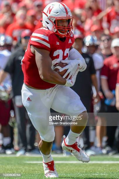 Running back Devine Ozigbo of the Nebraska Cornhuskers runs against the Troy Trojans at Memorial Stadium on September 15 2018 in Lincoln Nebraska