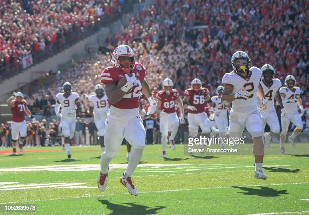 Running back Devine Ozigbo of the Nebraska Cornhuskers scores against the Minnesota Golden Gophers in the first half at Memorial Stadium on October...