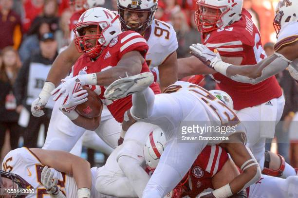 Running back Devine Ozigbo of the Nebraska Cornhuskers stretches for more yards against the Minnesota Golden Gophers at Memorial Stadium on October...