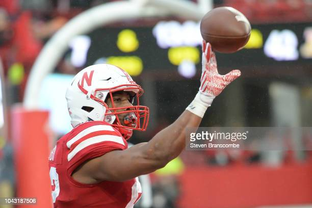 Running back Devine Ozigbo of the Nebraska Cornhuskers tosses the ball back to an official after a score against the Purdue Boilermakers at Memorial...