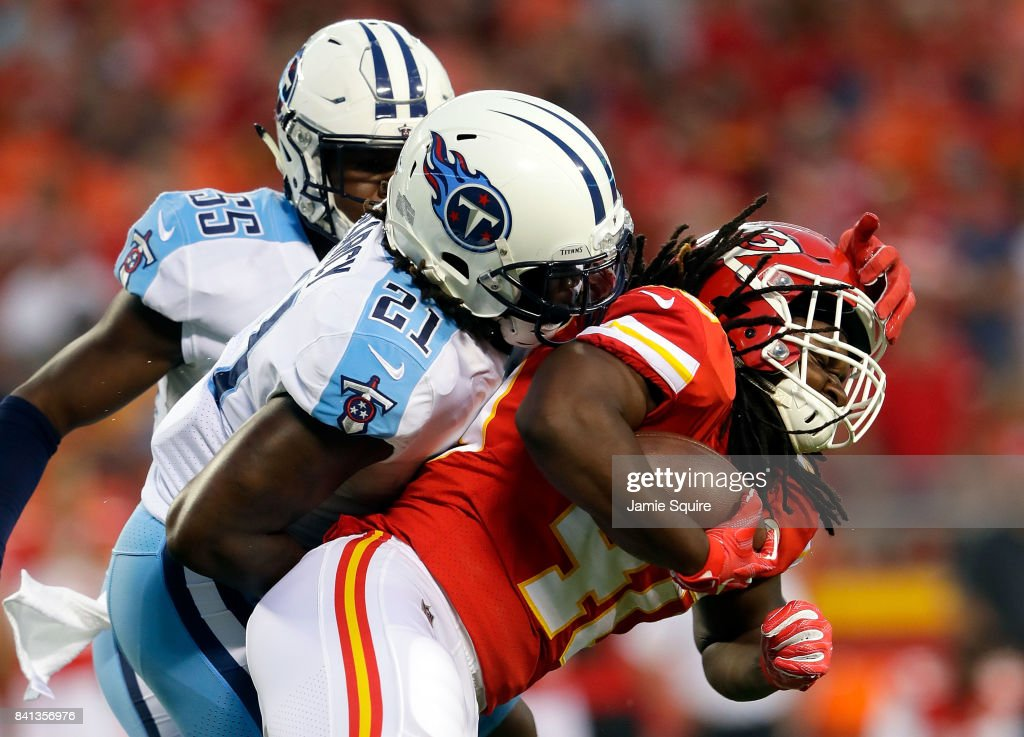 Running back Devine Redding #40 of the Kansas City Chiefs carries the ball as strong safety Da'Norris Searcy #21 of the Tennessee Titans defends during the game at Arrowhead Stadium on August 31, 2017 in Kansas City, Missouri.