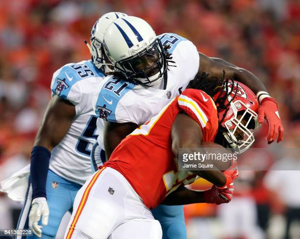 Running back Devine Redding of the Kansas City Chiefs carries the ball as strong safety Da'Norris Searcy of the Tennessee Titans defends during the...