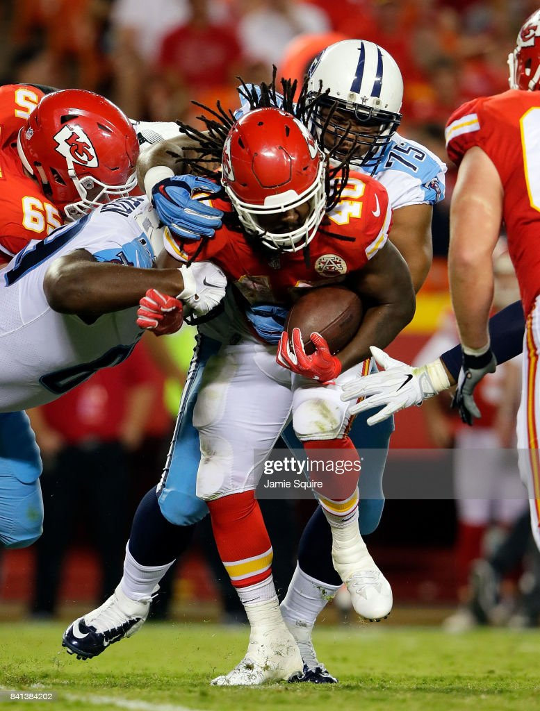 Running back Devine Redding #40 of the Kansas City Chiefs carries the ball during the game against the Tennessee Titans at Arrowhead Stadium on August 31, 2017 in Kansas City, Missouri.