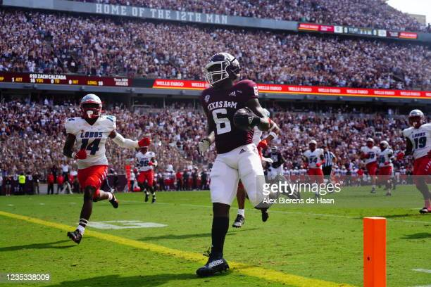 Running back Devon Achane of the Texas A&M Aggies scores a touchdown in the first quarter against the New Mexico Lobos at Kyle Field on September 18,...