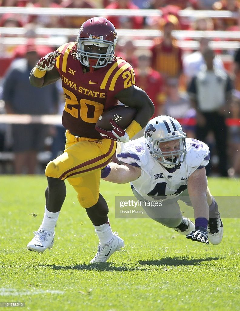 Running back DeVondrick Nealy #20 of the Iowa State Cyclones rushes for yards pas defensive end Ryan Mueller #44 of the Kansas State Wildcats in the second half of play at Jack Trice Stadium on September 6, 2014 in Ames, Iowa. Kansas State won 32-28 over the Iowa State Cyclones.