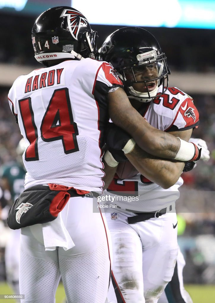 Running back Devonta Freeman #24 of the Atlanta Falcons celebrates his touchdown with teammate wide receiver Justin Hardy #14 against the Philadelphia Eagles during the second quarter in the NFC Divisional Playoff game at Lincoln Financial Field on January 13, 2018 in Philadelphia, Pennsylvania.