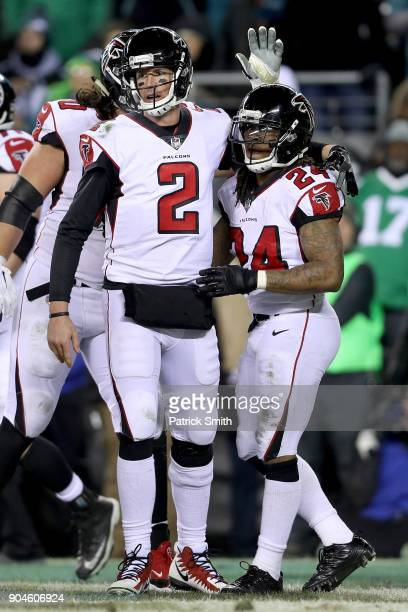 Running back Devonta Freeman of the Atlanta Falcons celebrates with Matt Ryan after his touchdown against the Philadelphia Eagles during the second...