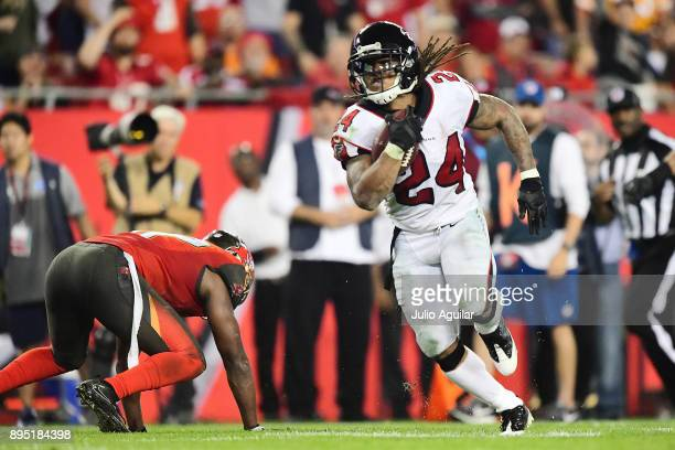 Running back Devonta Freeman of the Atlanta Falcons runs in a touchdown in the fourth quarter against the Tampa Bay Buccaneers on December 18 2017 at...