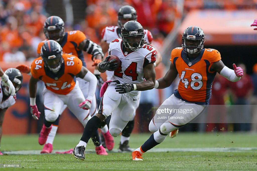 Running back Devonta Freeman #24 of the Atlanta Falcons runs with the ball in the game against the Denver Broncos at Sports Authority Field at Mile High on October 9, 2016 in Denver, Colorado.