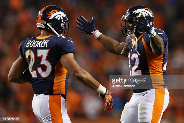 Running back Devontae Booker and running back CJ Anderson of the Denver Broncos celebrate a score in the second half of the game against the Houston...