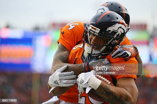 Running back Devontae Booker of the Denver Broncos celebrates with wide receiver Cody Latimer after rushing for a touchdown in the second quarter of...